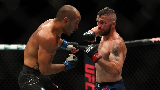 In this Nov 18, 2017 photo, in Sydney, Australia; Damien Brown moves in with a hit against Frank Camacho during UFC Fight Night at Qudos Bank Arena.