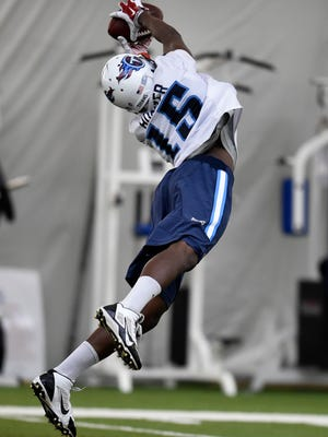 Titans wide receiver Justin Hunter (15) makes a leaping catch during practice at Saint Thomas Sports Park on Monday. Hunter's preliminary hearing on a felony assault charge in Virginia has been moved to Sept. 1.