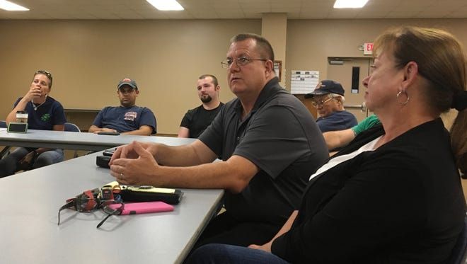 Augusta County supervisor Terry Kelley speaks with members of the Verona Volunteer Fire Company at their monthly meeting at the station on Monday, Aug. 14, 2017.