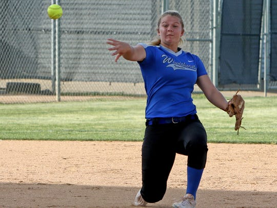 Windthorst's Tatum Veitenheimer throws to first but can't get the out against Albany Thursday, May 10, 2018, in Game 1 of the Region I-2A quarterfinal series in Graham.