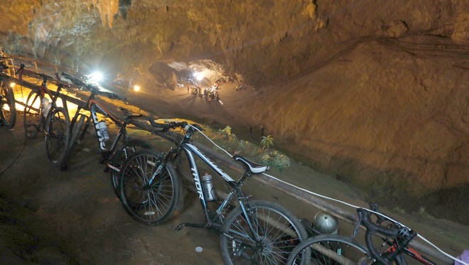 Bicycles left by a group of missing boys lean against a railing at the entrance of a deep cave in Chiang Rai, northern Thailand, Monday, June 25, 2018.
