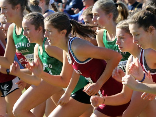 South Kitsap's Paxton DePoe, center, leaves the starting line at Saturday's district cross country race at Chambers Bay in University Place.