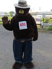 Smokey Bear is ready to race at the annual Smokey Bear Fun Run at 7:30 a.m. in Capitan July 4.