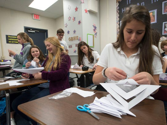 Michaela O'Grady, right, helps other student government