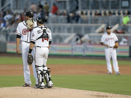El Paso pitcher Dinelson Lamet chats with catcher Miguel