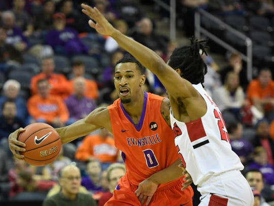 University of Evansville's Ryan Taylor (0)  drives