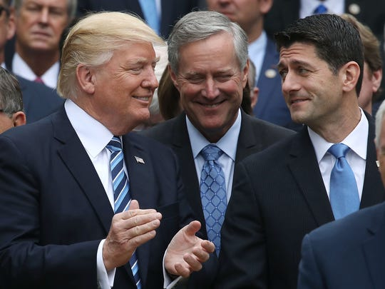 President Donald Trump (L), stands with  House Speaker Paul Ryan, R-Wis., and Freedom Caucus Chairman Mark Meadows, R_N.C., after Republicans passed legislation aimed at repealing and replacing ObamaCare, during an event in the Rose Garden at the White House, on May 4, 2017 in Washington, D.C.