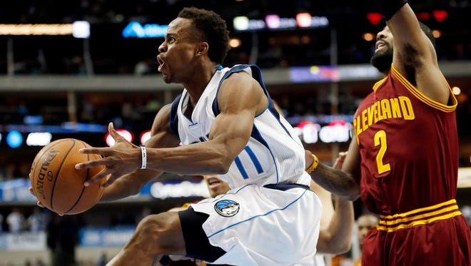 Dallas Mavericks guard Yogi Ferrell (11) jumps past Cleveland Cavaliers guard Kyrie Irving (2) and forward Richard Jefferson (24) during the second half of an NBA basketball game, Monday, Jan. 30, 2017, in Dallas. Dallas won 104-97.