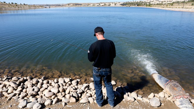 Josh Ashton fishes on Tuesday at Tiger Park Reservoir in Aztec.