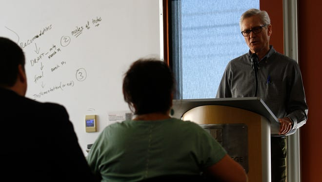 Al Duerr, founder and chief executive officer of General Magnetic International Inc., delivers a presentation on his company Wednesday at San Juan College's School of Energy in Farmington.