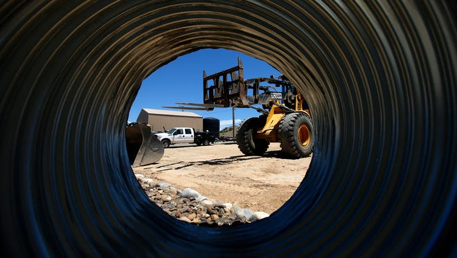 Work continues on a water project Thursday at the Animas Valley Water Company in Crouch Mesa.