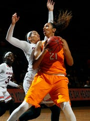 Tennessee's Mercedes Russell turns to shoot to the