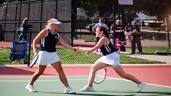 Hayden seniors Jenny Voegeli, left, and Allyson Meier won the doubles championship in Saturday's Class 4A girls tennis regional at Prairie Village.