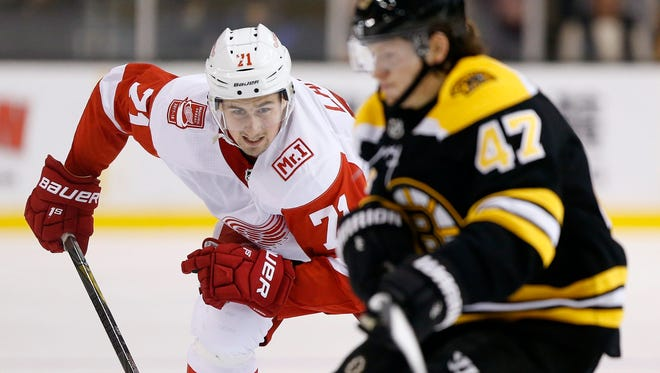 The Detroit Red Wings' Dylan Larkin pursues the Boston Bruins' Torey Krug during the third period Saturday.