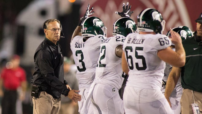 Mark Dantonio's team suffered extensive player losses after last year but doesn't have the luxury to infuse talent like at Alabama, Ohio State.