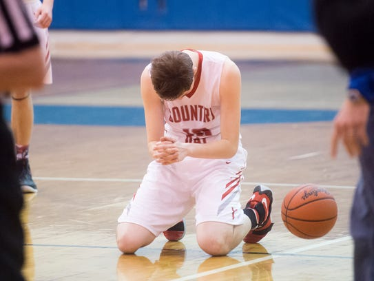 York Country Day's Greg Gladfelter reacts after falling