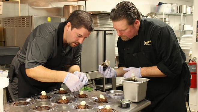 Matt Williams and Christian Fuller of Connors Steak & Seafood prepare a Best of the Taste entry in 2014.