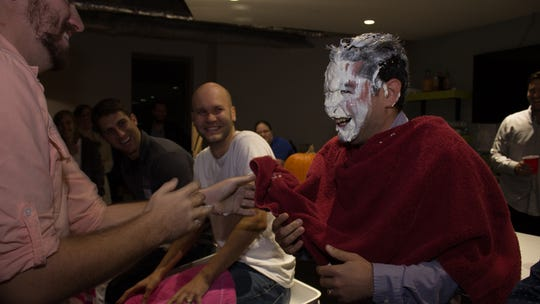 Scott Resnick after getting a pie in the face at EatStreet's