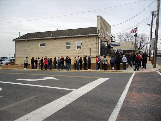 Customers lined up the day Mike's Giant Size Submarine Sandwiches reopened after superstorm Sandy.