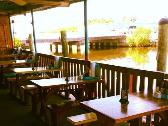 The Olde Fish House on Matlacha offers local seafood and a waterfront, open-air dining area.