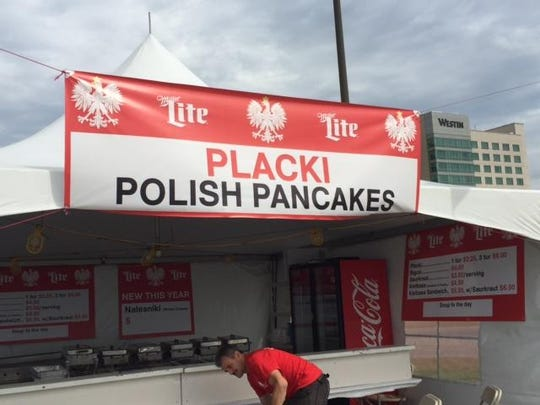 Krzysztof Zarzecki sets up the Placki or Polish Pancakes booth before the start of the 59th annual Polish Festival.