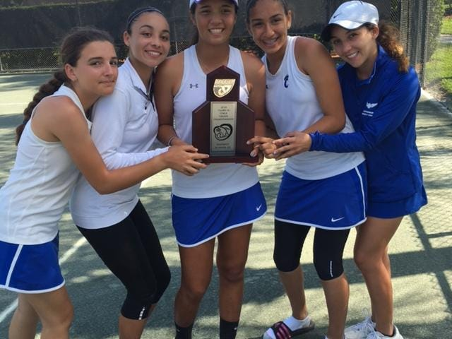 The Canterbury girls tennis team celebrates after placing second at the District A-10 championship match.