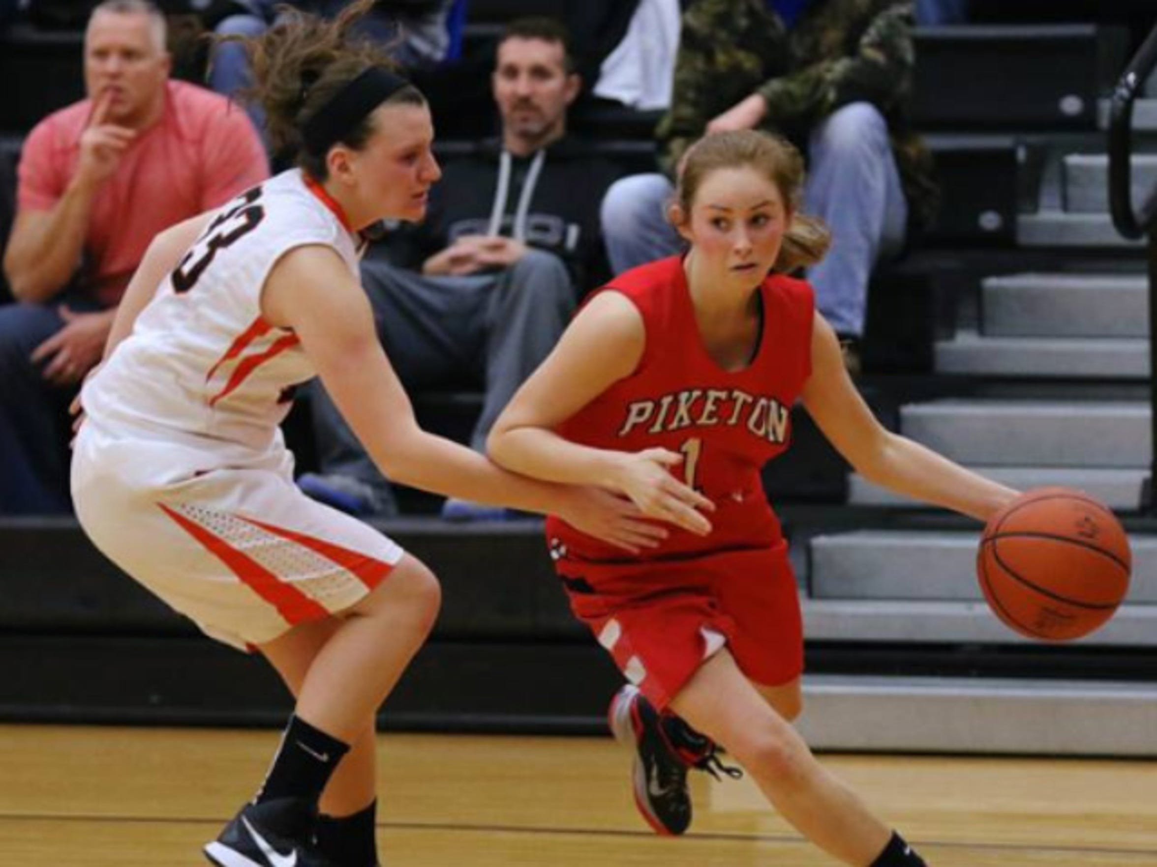 Piketon's Payton Reuter drives past a Waverly defender
