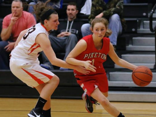 Piketon's Payton Reuter drives past a Waverly defender in the 2014 Pike County Holiday Classic. Piketon won the game, 44-25, to take the tournament crown.