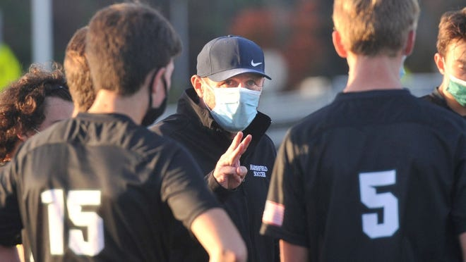 Marshfield High Boys Soccer Head Coach Paul Turner instructs his team during their recent match with Hingham.
