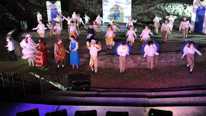 The finale of the Beauty and the Beast Jr. is illuminated by colored lights at the Ruth Gordon Amphitheatre in Quincy by the Mel O'Drama Acting School of Quincy, Friday, Sept. 11, 2020. Tom Gorman/For The Patriot Ledger