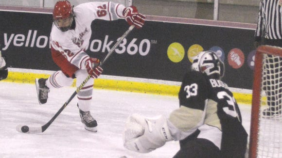 Fair Lawn junior forward Alex Acres taking aim against River Dell/Westwood goalie Michael Bussanich.