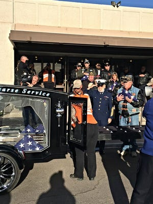 Cremains are loaded into a hearse as 42 veterans who were never claimed after death are laid to rest in Phoenix.
