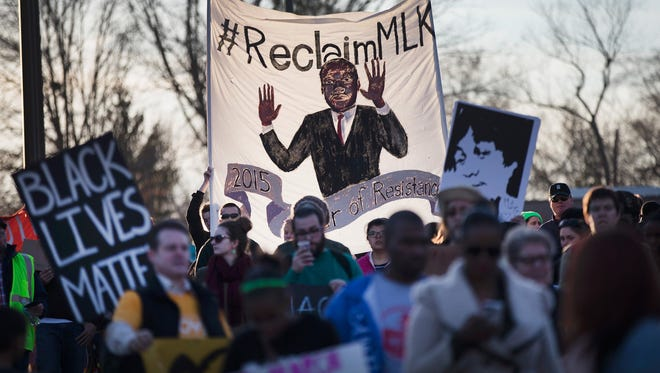 Demonstrators remember Michael Brown with a Martin Luther King Jr. Day march from the apartment complex where he was killed to the Ferguson, Mo., police station on Jan.19.