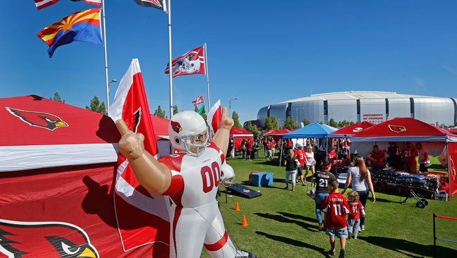 Football fans tailgate on The Great Lawn prior to the Arizona Cardinals vs St. Louis Rams NFL game Sunday, Nov. 9, 2014 in Glendale.