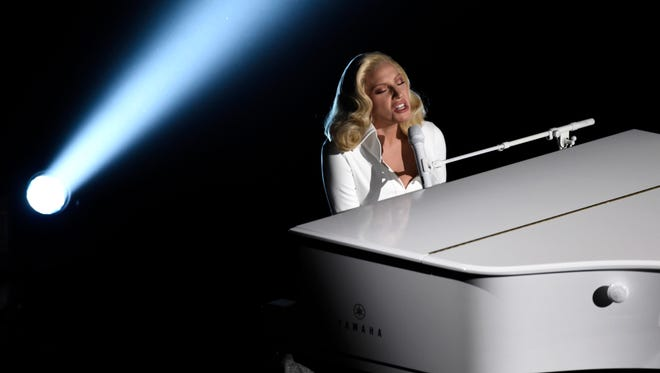 FILE - In this Feb. 28, 2016 file photo, Lady Gaga performs at the Oscars at the Dolby Theatre in Los Angeles. Lady Gaga and Vice President Joe Biden are bringing their act to Las Vegas for an event raising awareness about sexual assault. The pop star and the vice president will hold a rally at the University of Nevada, Las Vegas, on April 7. (Photo by Chris Pizzello/Invision/AP, File)