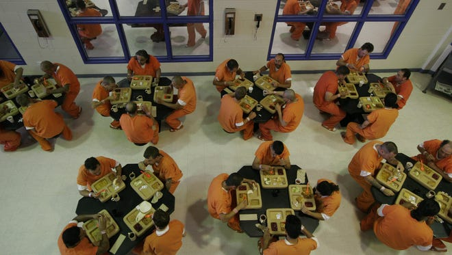 The Larimer County Detention Center could hit its 600-person limit this weekend, prompting top brass to urge local law enforcement to exercise extreme discretion before making an arrest. This 2006 Coloradoan file photo shows an intake area.