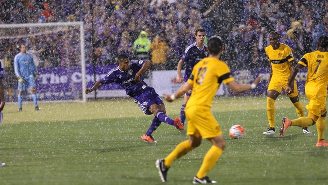 Louisville City FC's Sean Reynolds, #15, passes in heavy rain against the Pittsburgh Riverhounds' during their match at Slugger Field.Apr. 27, 2016