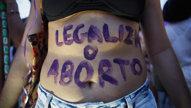 A supporter of legalizing abortion poses during a march for women's rights on International Women's Day on March 8, 2016 in Rio de Janeiro, Brazil.