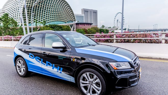 "Delphi Automotive and Mobileye are collaborating on technologies that should enable cars to operate at full autonomy by late 2019 or early 2020. This is one of the automated Audi SQ5's that Delphi is using to a new ""first mile"" and ""last mile"" system to augment the public transit system of Singapore."