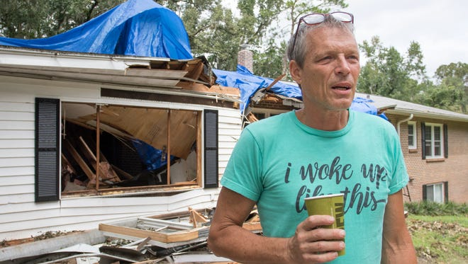 Dennis Kilfoy stands outside of his house on Domingo Drive that was severely damaged by a fallen tree during Hurricane Hermine in Tallahassee, FL on Sunday, September 4, 2016.
