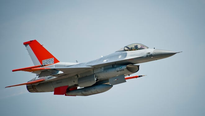 A QF-16 flies across the horizon at Tyndall Air Force Base, Fla., May 12, 2016. The QF-16 is a full-scale aerial target that has been modified to be flown with a pilot in the cockpit for training and also without a pilot as a target for live missile testing. The 82nd ATRS received their first QF-16 in September 2014 and will continue to transition their FSAT program to the new model over the next several months