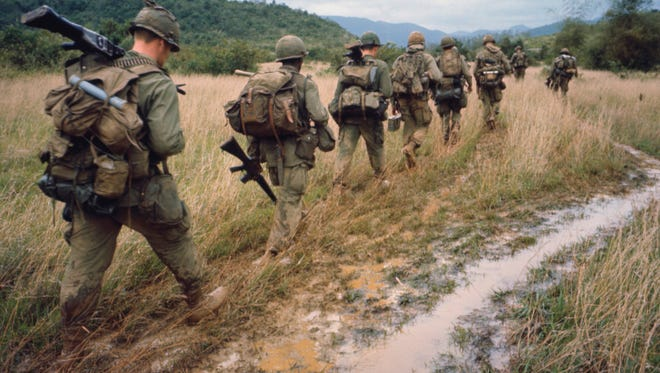 """Soldiers on patrol during the Vietnam War.  Ken Burns and Lynn Novick's 10-part film, """"The Vietnam War,"""" recently aired on PBS, inspiring a look at Vietnam books."""