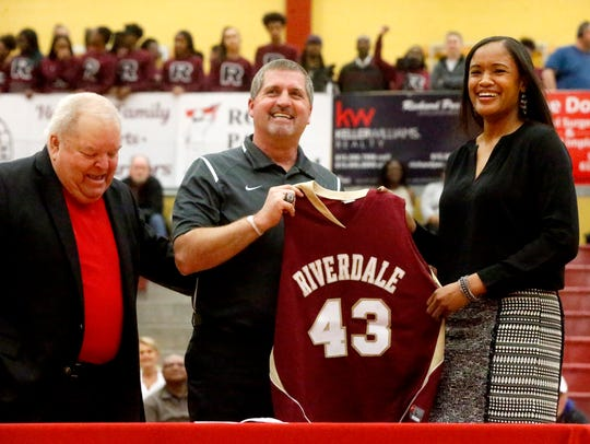 Former Riverdale and MTSU standout Krystle Horton (right), an assistant with the Lady Warrior program, is shown having her jersey retired earlier in the season. Also pictured are former Riverdale coaches Jeff Jordan (left) and Randy Coffman (center).