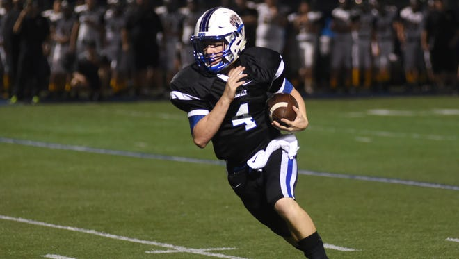 Zanesville's Ben Everson heads to the endzone to score against Miami Trace Friday night at Sulsberger Stadium.