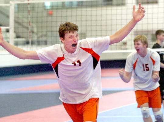 Paul Kuhn celebrates Central York's PIAA Class AAA championship in June 2011. The Juniata College sophomore was named to the American Volleyball Coaches Association All-America second team. (GameTimePA.com -- File)