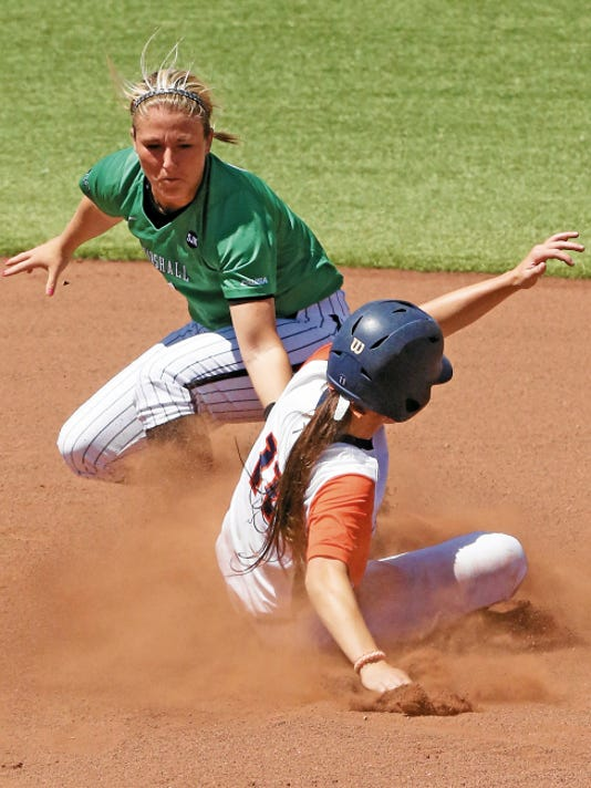 Rudy Gutierrez—El Paso Times UTEP's Ashley Eldridge, bottom, gets to second base just before the tag from Kylie Howard of Marshall during the first game of a doubleheader Saturday at Helen of Troy field.