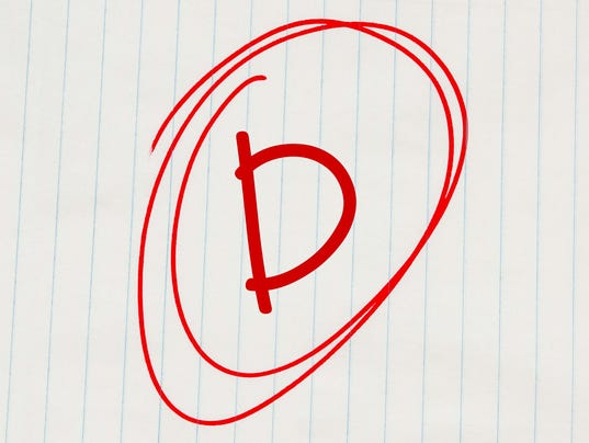 D grade written in red on notebook paper