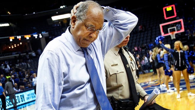 Dejected University of Memphis head coach Tubby Smith walks off the court after a 74-62 loss to Temple University at the FedExForum.