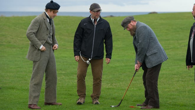 """Actors Jack Lowden (left) and Peter Mullan (right) work out a scene with director Jason Connery (center) during filming of """"Tommy's Honour."""""""