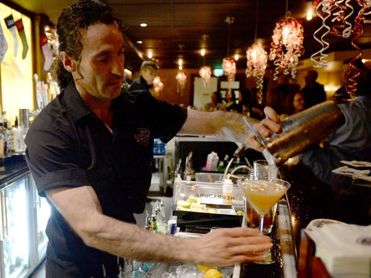 Ray Harvey, a bartender at Ace Gillett's Lounge in